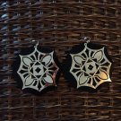 Black acrylic and gold metal decor earrings