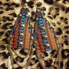 Tribal print mega triangle fashion earrings