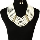 Long bold chunky pearl with gold necklace