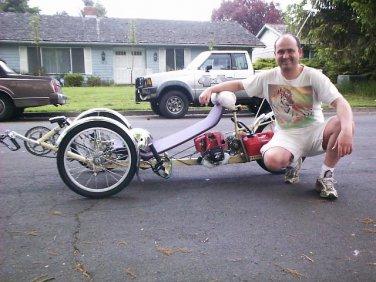 NomadOmatic  a 230 MPG recumbent tandem tadpole bicycle class tadpole trike