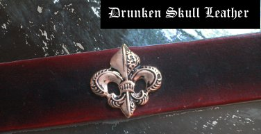leather cuff with Fleur de lis concho and red to black fade dye