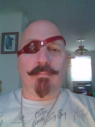 Leather eye patch with skull and cross bones