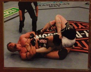 Former UFC MMA Champ FRANK MIR kneebars Brock autographed signed 8x10 photo