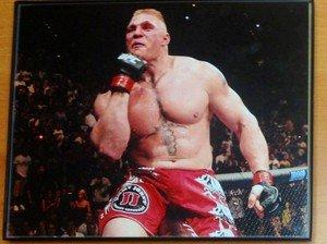BROCK LESNAR celebrates after UFC 116 win framed 8x10 photo WWE