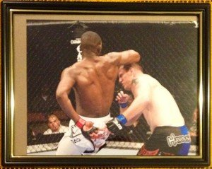 "UFC Champ JON ""BONES"" JONES SPINNING ELBOW on O'Brien framed 8x10 photo"
