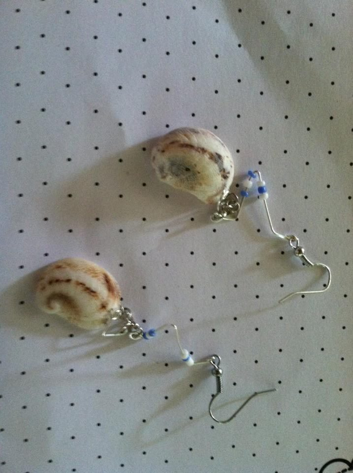 Silver shell earrings with white and light blue beads.