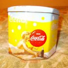 """Coca Cola Tin Canister Lady on beach Coca Cola bottle  5"""" Wide x 10"""" Tall"""