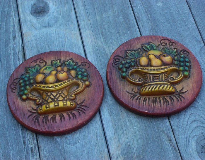 Two old wall plaques with fruit basket