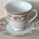 Beautiful Footed Cup & Saucer Set Made In China. Rose Decoration and Gold Trim