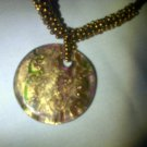 Gold tone murano glass pendant and beaded necklace