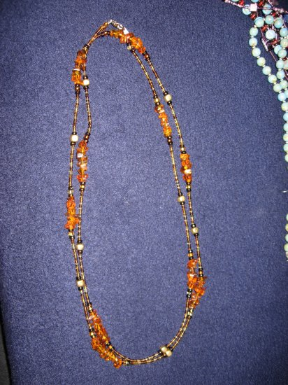 Beautiful amber looking stones and gold-like spacers