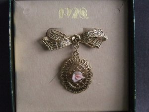 1928 Jewelry Company Victorian Style Pin with Bow and Roses