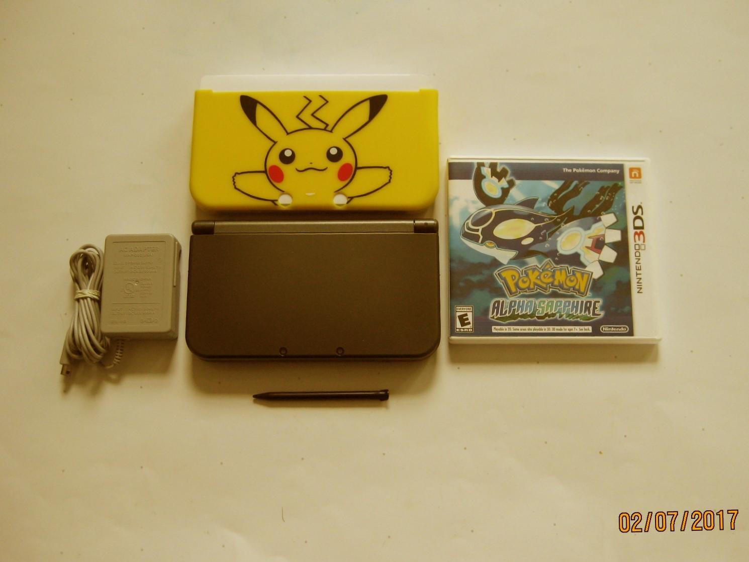 Nintendo New 3DS XL Black w Pokemon Alpha Sapphire & More !!