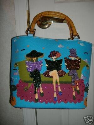Three Ladies Sitting On Couch Handbag