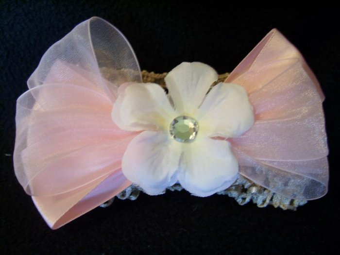 White flower on pink bow