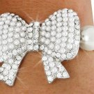 SWW18664B - CREAM FAUX PEARL AND SILVER TONE AUSTRIAN  CRYSTAL ACCENTED BOW STRETCH BRACELET