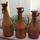 Tri of Leather Wrapped Clay Bottles with Juke and Wooden Bead accents - 11 to 14 inches Tall!