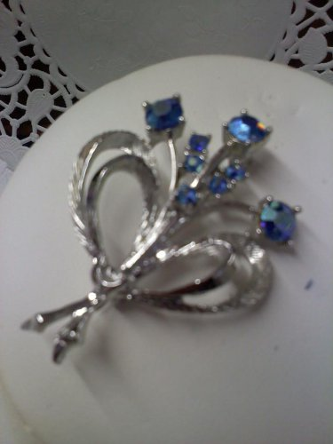 Sparkly blue aurora borealis bouquet by Dodds vintage brooch pin
