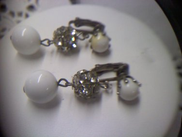 Vintage milk glass and rhinestone prong set orbs in silvertone clip earrings