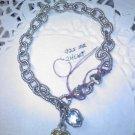 Judith Ripka twin hearts charm bracelet in 925 sterling silver