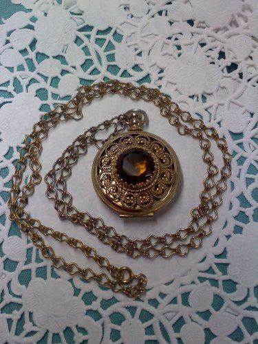 Avon vintage -Victorian Locket Necklace- with faux amber topaz in goldtone
