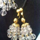 Avon clear faux crystal chandelier clip earrings on goldtone from 1992