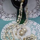 Faux pearl, faux gold and a brass filigree topped tassel necklace with clip earrings