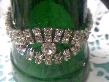 Two strand rhinestone bracelet with 3 large center rhinestones