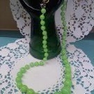 Vintage 20 inch pale lime green hand knotted necklace