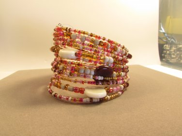 Handmade Indonesian Tribal Seed Bead Bracelet Cuff adorned shell, stone chips, and glass beads.