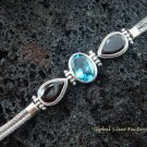 Sterling Silver Blue Topaz and Garnet Bracelet SBB-102-KT