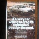 Vintage Print Ad 1985 Subaru sedan through the mud