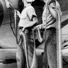 New 5x7 World War II Photo: Ordnancemen Loading Ammo into SBD-3