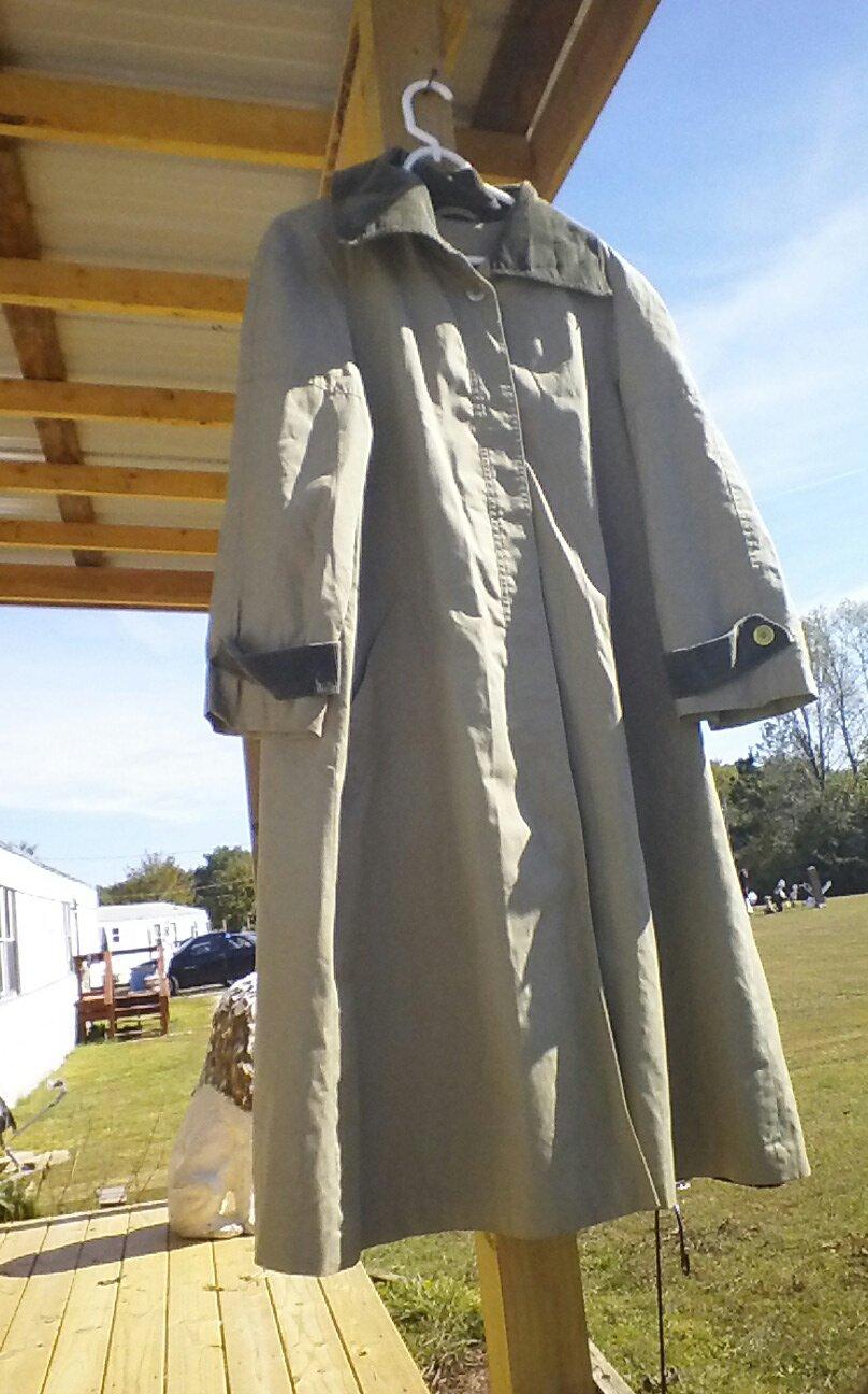 Woman's tan raincoat size 15/16