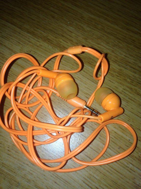orange ear bud headphones