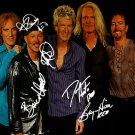 reoSpeedwagonLarge Autographed Preprint Signed Photo