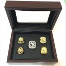 A Set New York Yankees World Series championship rings size 11 with wooden case