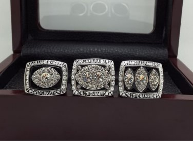 A Set Oakland Raiders XI XV XVIII super bowl championship ring size 11 with wooden case
