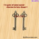 A pair of metal charms with brown color KEY shape to opening the door to happiness(bc08)