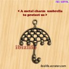 A metal charm with bronze color umbrella to protect us (bc19)
