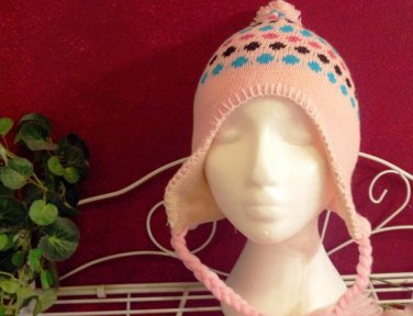 Girl's knitted winter hat by Solid Wing, color: Pink, braided ties with tassel, pompom