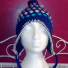 Girl's knitted winter hat by Solid Wing, color: Navy, braided ties with tassel, pompom