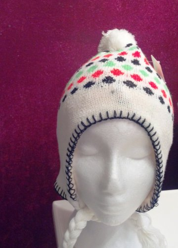 Girl's knitted winter hat by Solid Wing, color: White, braided ties with tassel, pompom