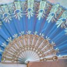"Folding Fan, Sky Blue silk with gold and white design by ""Silk Breeze"""