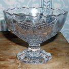 Vintage pressed glass footed dessert bowl with a diamond pattern