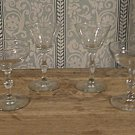 Four Vintage wine and champagne glasses with elegant  stems