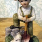 Ceramic bisque Boy with Shovel, Puppy at his feet