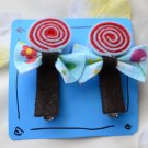 blue and red lollipop hair clips