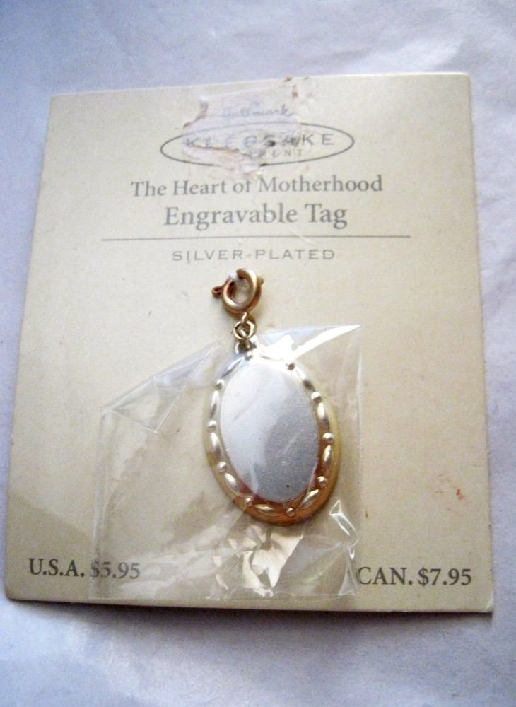 "Hallmark Keepsake The Heart of Motherhood silver plated charm Tag 1.25"" x .75"""