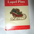 """VTG 1985 Hallmark gold tone green & red acrylic sleigh 1.5"""" x 2"""" pin brooch NOS"""